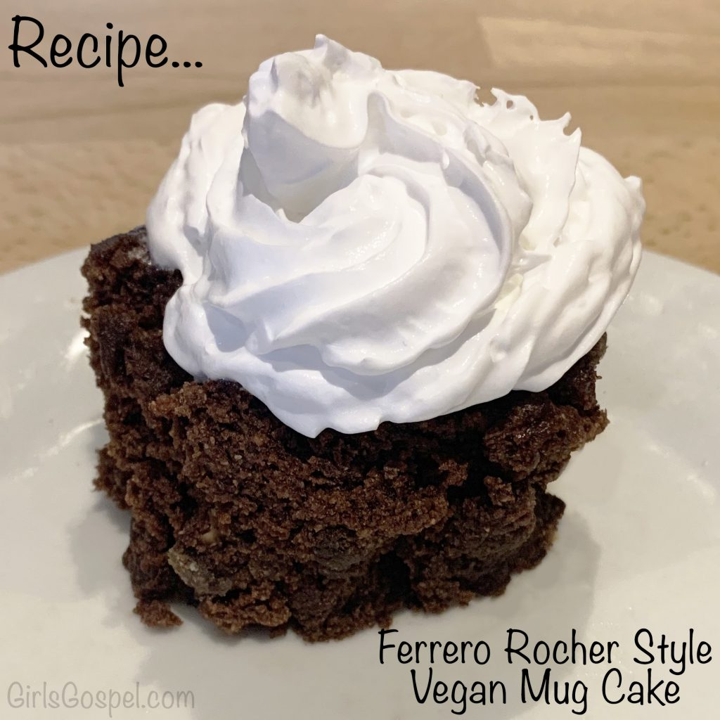 Ferrero Rocher style vegan mug cake - Finished cake, turned out onto a plate with vegan cream on top.