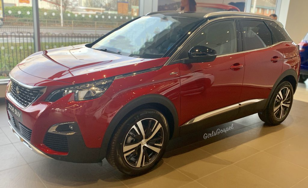 Peugeot 3008 GT Line - side view of the red one.