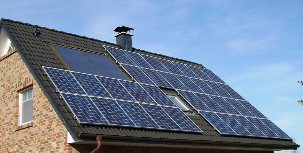 making your home more energy efficient - solar panels on a roof