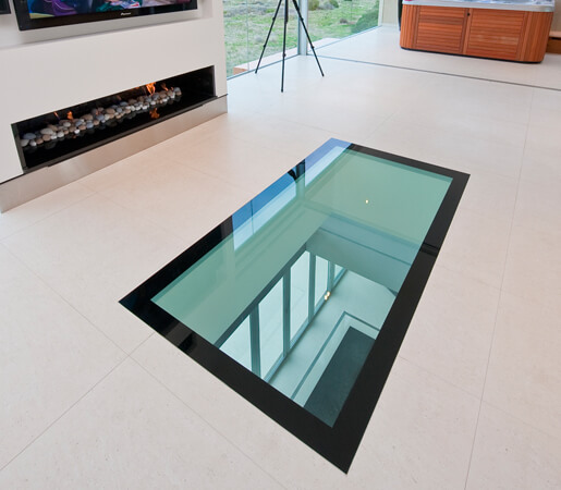 add natural light to your basement - glass floor panel