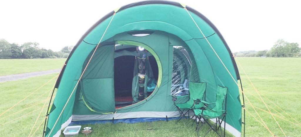 pitched Coleman Valdes 4 tent banner