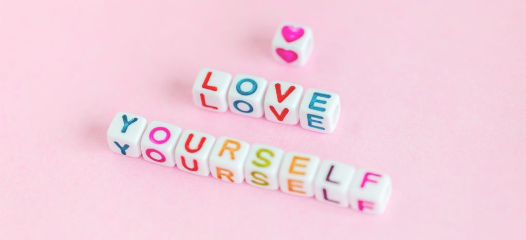 love yourself written in cubes