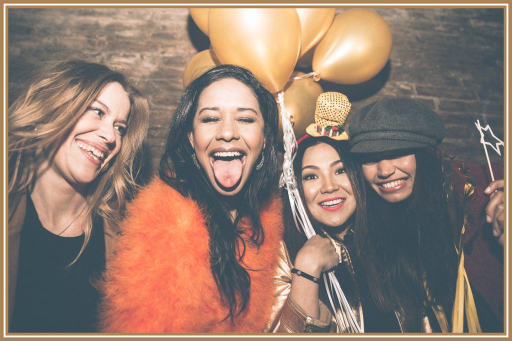 4 women in a nightclub banner