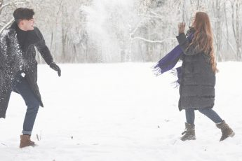 young couple playing in the snow Dating Over Christmas During Lockdown after seeing these winter date ideas